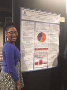 Courtney Maclin-Akinyemi presenting her poster at SBM 2018